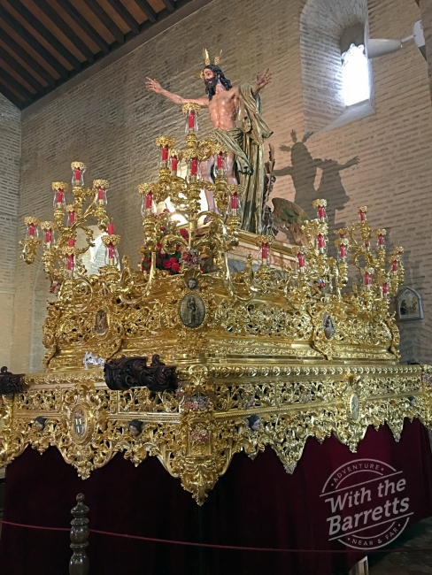 Gold float with figure of Jesus