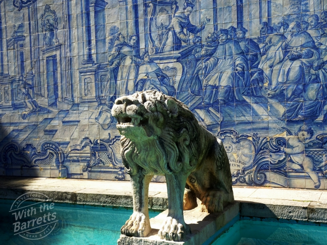 Lion sculpture with tile background