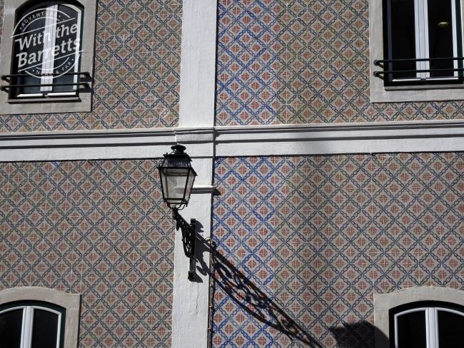 Sun-faded tile cladding
