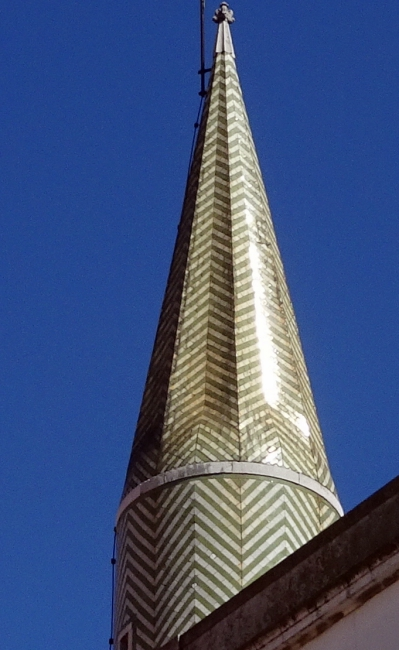 Tile-clad conical roof feature