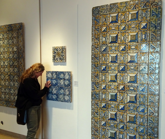 Debra touching tile exhibit